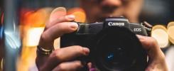 Man holding Canon EOS RP